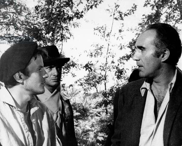 Michel Piccoli with two collegues in a scene of the film 'Un homme de trop', 1967 (b/w photo)