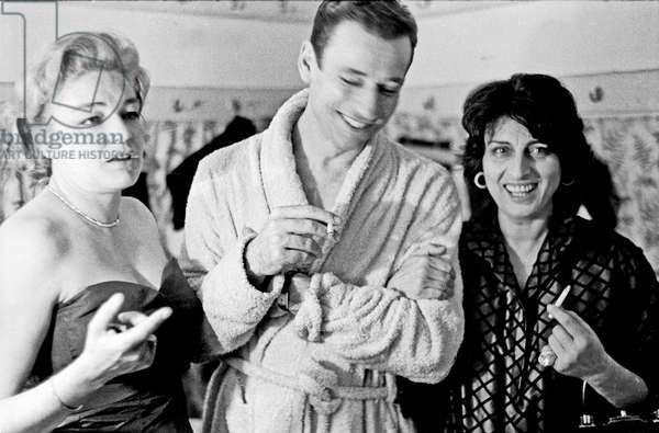Yves Montand with Simone Signoret and Anna Magnani in the dressing room, Rome, Italy, 1959 (b/w photo)
