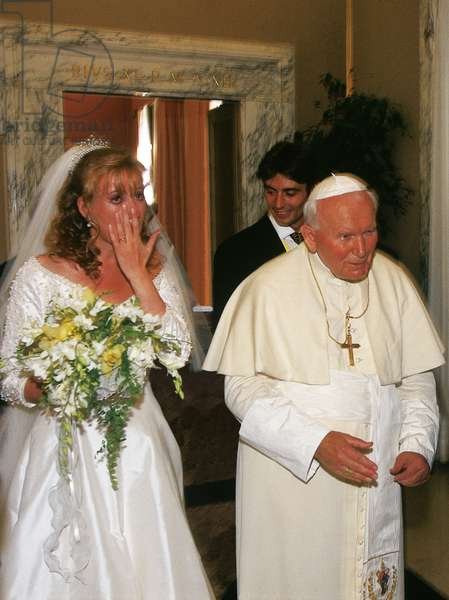 Pope John Paul II blessing a married couple