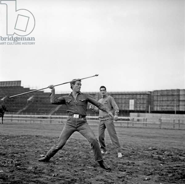 Charlton Heston training in the throwing of the javelin on the movie set of Ben Hur, Rome, Italy, 1958 (b/w photo)
