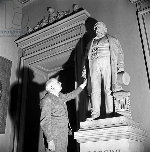 Alberto Savinio touching the statue of Gioachino Rossini, Milan, Italy