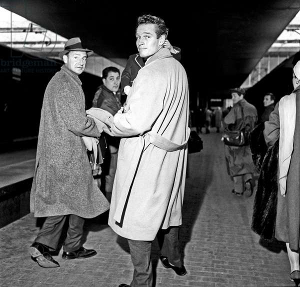 Charlton Heston and his son at Termini railway station, Rome, Italy, 1958 (b/w photo)