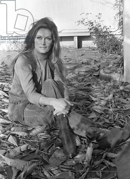 Dalida posing in her garden, France, 1968 (b/w photo)