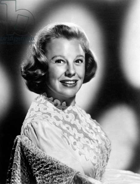 A smiling June Allyson poses