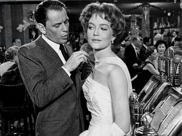 Frank Sinatra makes a key glide into the neckline of Patricia Wymore's dress, Las Vegas, United States