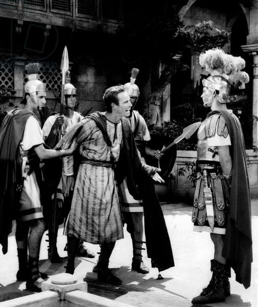 A scene from the film Ben-Hur with a chained Charlton Heston