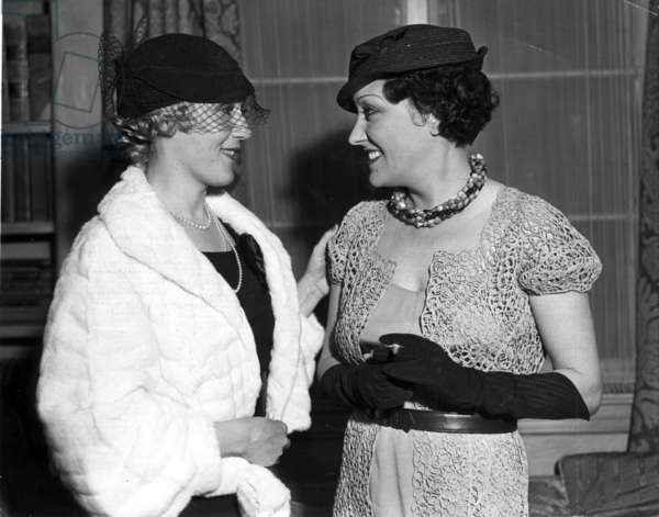 Gloria Swanson and Mary Pickford smiling