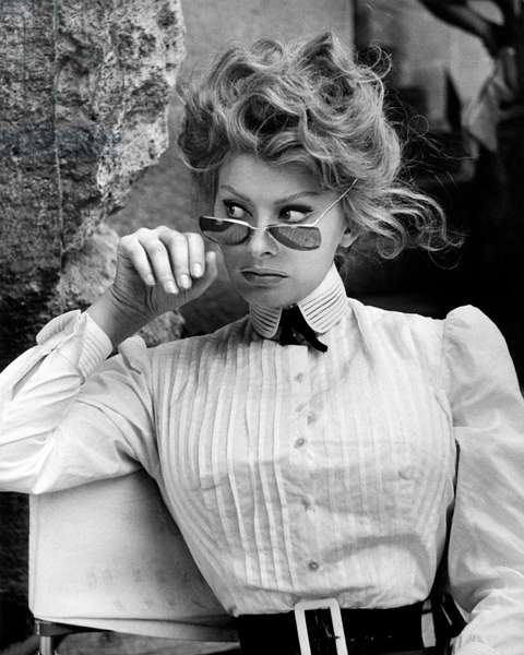 Sophia Loren with sunglasses in a scene from the movie 'A Breath of Scandal', 1960 (b/w photo)