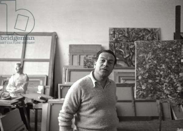 Renato Guttuso in his study (b/w photo)
