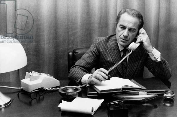 Rossano Brazzi on the phone, 1970s (b/w photo)