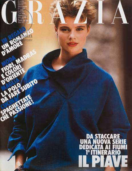 Cover of the women magazine Grazia, Model wearing an Issey Miyake sweater: rough cotton slouch tunic with cowl neck, With it: earrings by Merù and bracelet by Pellini, Photo by Stefano Massimo, 1984 (b/w photo)