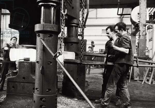Workers on the job, 1963 (b/w photo)