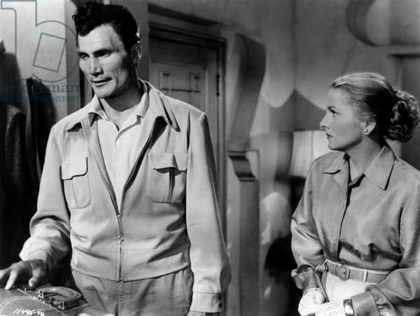Jack Palance and Joan Fontaine in a scene from 'Flight to Tangier', 1953 (b/w photo)