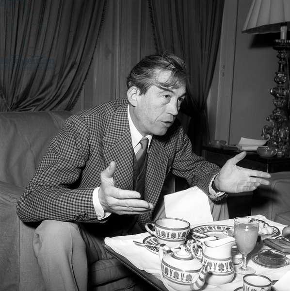 John Huston having breakfast in Rome, Rome, Italy