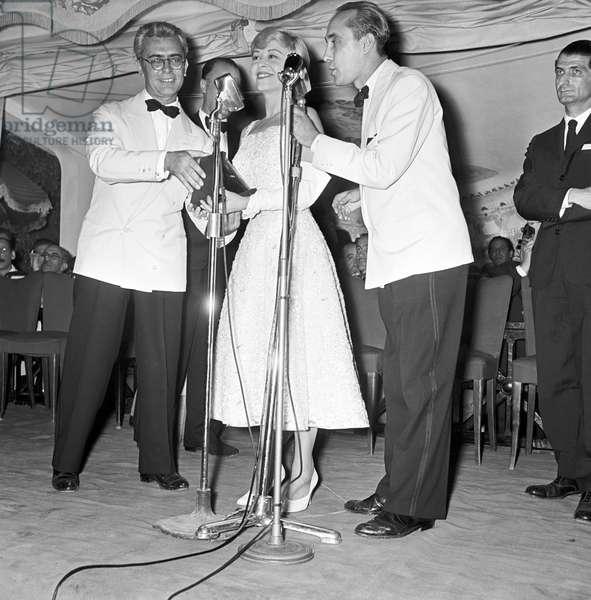 Giulietta Masina and Lello Bersani attending the Nastri d'Argento ceremony, Italy, 1955 (b/w photo)
