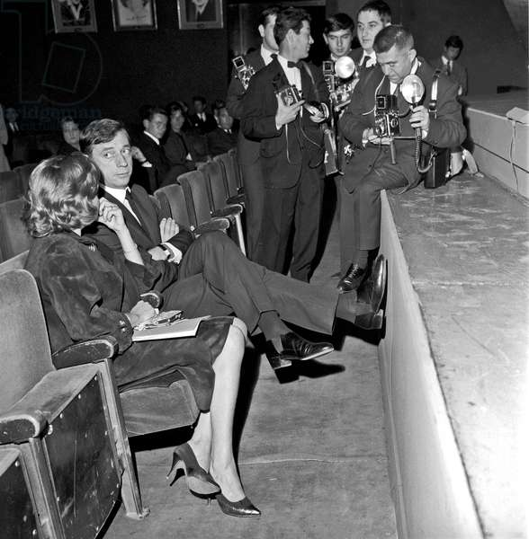 Yves Montand and Simone Signoret at Olympia Music Hall surrounded by photographers, Paris, France, 1962 (b/w photo)
