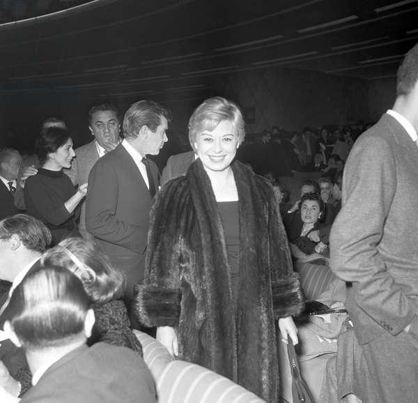 Giulietta Masina and Federico Fellini attending the premiere of the comedy L'adorabile Giulio, Italy, 1956 (b/w photo)