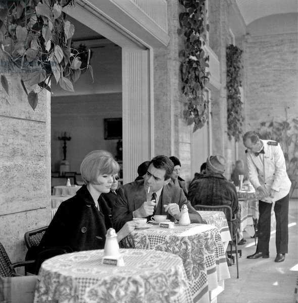 A couple in love sitting at the tables of a café, Italy