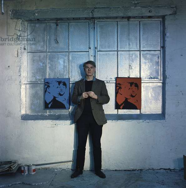 portrait of andy Warhol near two of his artworks in his workshop The Factory in NY, 1966 (0104699) (photo)