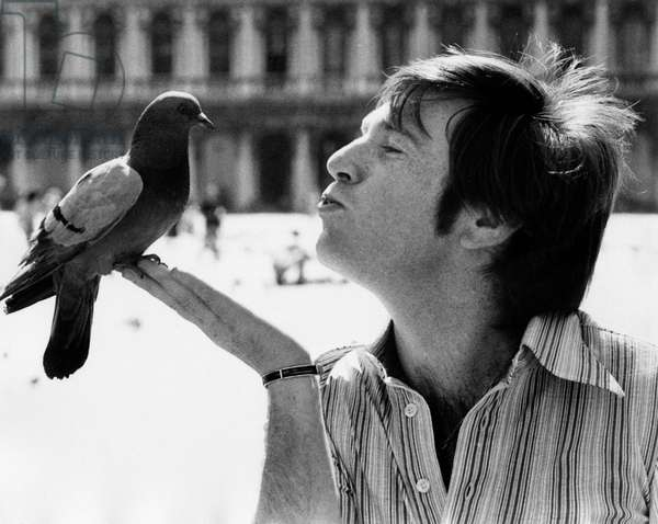 Enzo Cerusico jokes with a pigeon