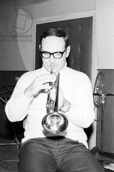 Ennio Morricone playing a trumpet, Italy, 1965 (b/w photo)