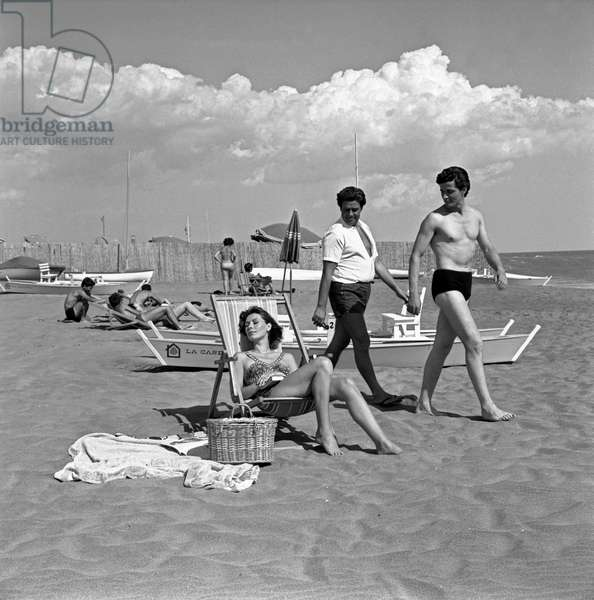 A woman on holiday being courted by two men, Italy