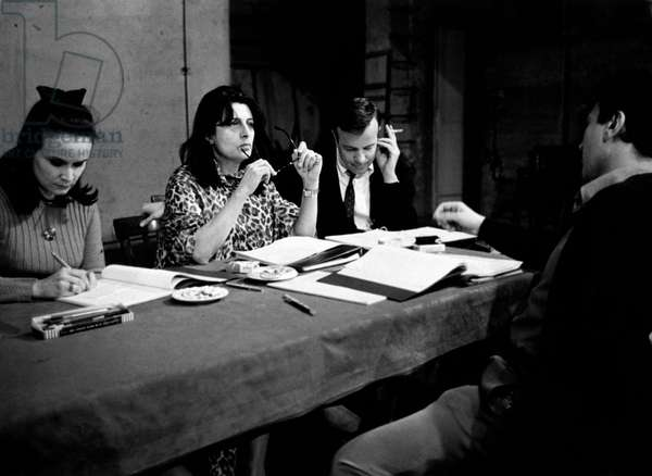 Anna Maria Guarnieri, Anna Magnani, Franco Zeffirelli and Osvaldo Ruggeri studying the script of 'La lupa', 1965 (b/w photo)