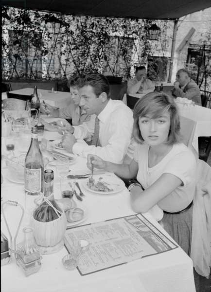 Yves Montand, Francoise Arnoul and Anouk Aimée at the restaurant, Italy, 1955 (b/w photo)