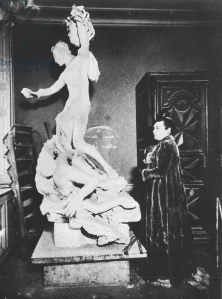 Camille Claudel working on her statue Perseus and the Gorgon, 1909 (b/w photo)
