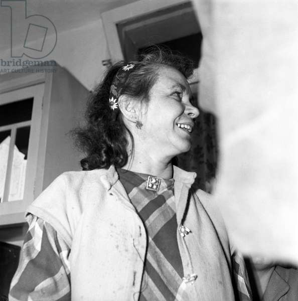 Gisella Giongo, former activist of Partito Popolare Trentino Tirolese, smiling during the regional election, Trento, November 1952 (b/w photo)