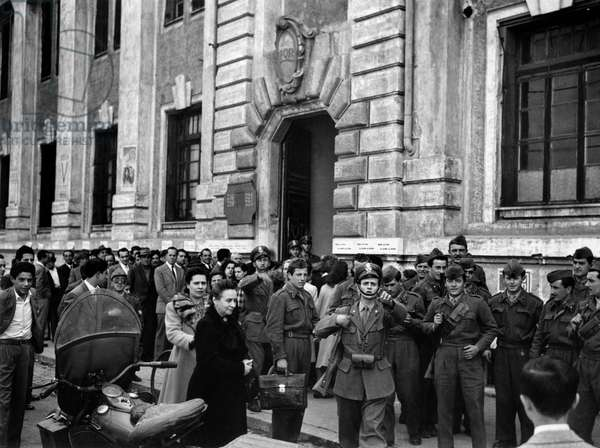 Military men outside a polling station in Rome, Rome, Italy