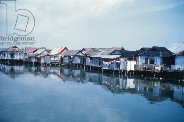 Palafittes along the River Singapore, Singapore, 1962 (b/w photo)