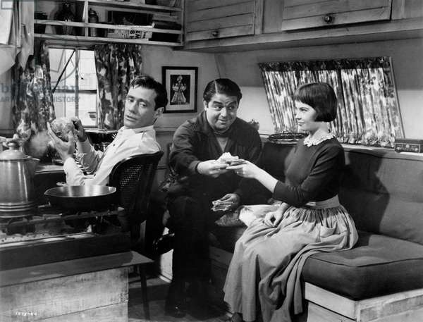 Leslie Caron, Mel Ferrer and Kurt Kasznarin a scene from the movie 'Lili', 1953 (b/w photo)