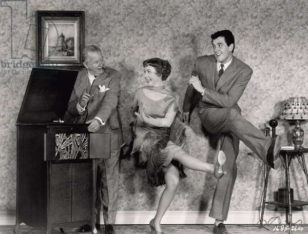 Rock Hudson, Piper Laurie and Charles Coburn dancing on the set