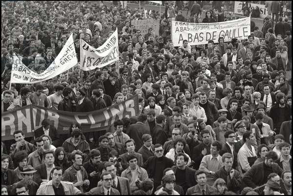 Banners against the President of the French Republic Charles de Gaulle (A bas de Gaulle) in a demonstration of young students and workers, who do not want to interrupt the general strike for what was granted by the trade unions in terms of minimum wage and civil rights. Paris (France), May 30, 1968 (b/w photo)
