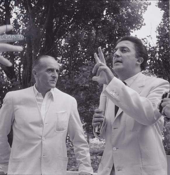 René Clair and Federico Fellini during the XVI Venice International Film Festival, Italy, 1955 (b/w photo)