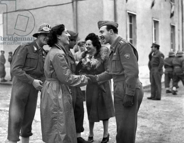 Women greeting Italian soldiers leaving Naples, Naples, Italy