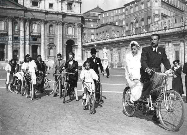 Newlyweds on a tandem bicycle