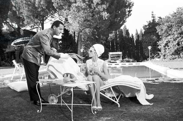 Alberto Sordi giving a review to Capucine in Sex quartet - segment Fata Marta, Italy, 1966 (b/w photo)