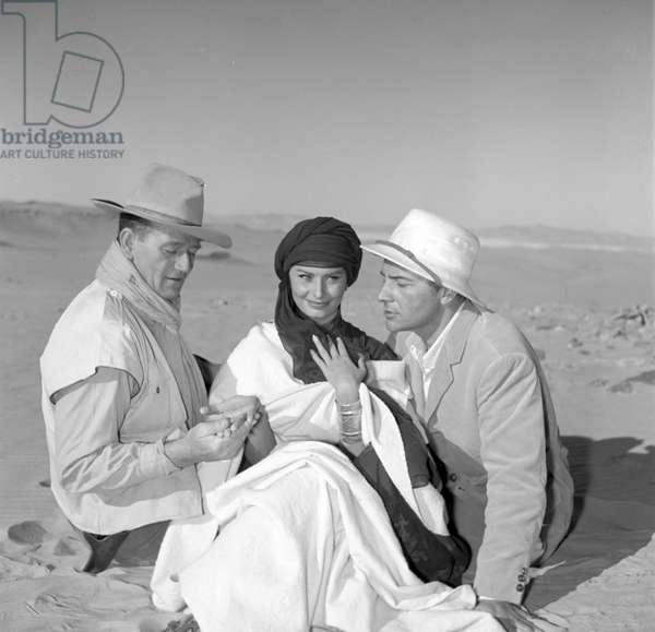 Sophia Loren, John Wayne and Rossano Brazzi on the set of 'Legend of the Lost', 1957 (b/w photo)