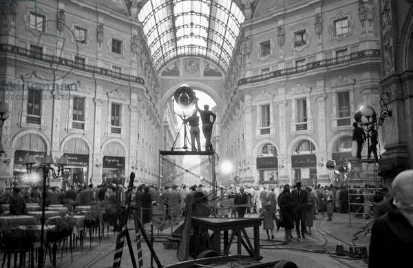 The striking Galleria Vittorio Emanuele II, equipped with scaffoldings and reflectors, has turned into a movie set for