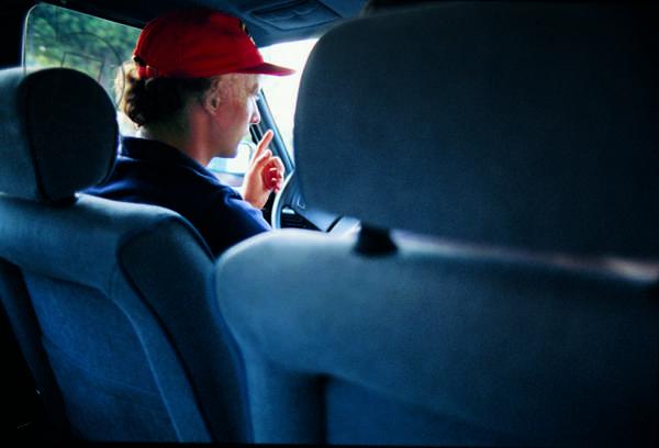 Niki Lauda sitting into a car