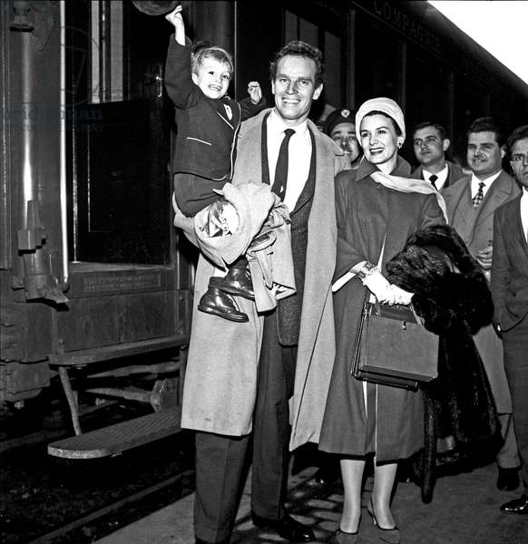 Charlton Heston arriving at Termini railway station with his wife and his son, Rome, Italy, 1958 (b/w photo)