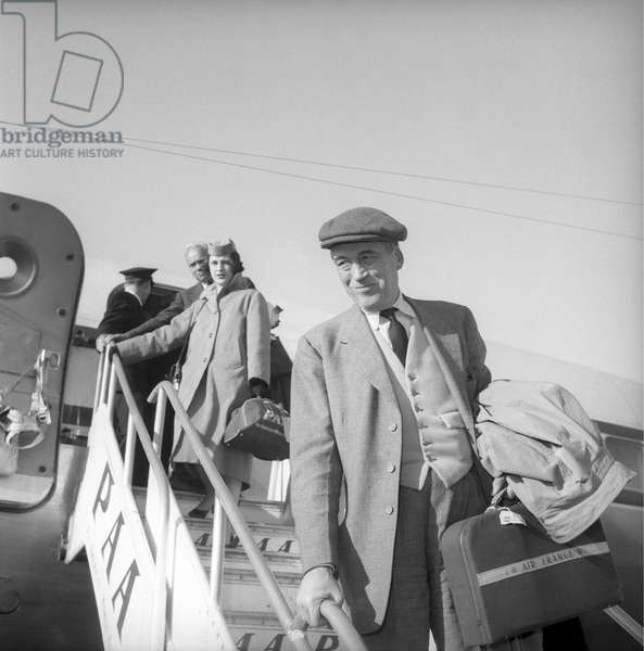 John Huston getting off an airplane at the Ciampino Airport, Rome, Italy