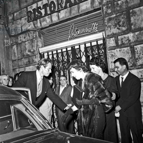 Charlton Heston with his wife and his mother leaving teatro Sistina, Rome, Italy, 1958 (b/w photo)