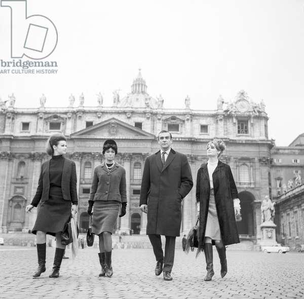 Sean Connery, Evanne Gillian, Seyn Seyna, Olivia Hill on Saint Peter's Squar, 1963 (b/w photo)