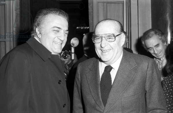 Roberto Rossellini and Federico Fellini smiling, Italy, 1975 (b/w photo)