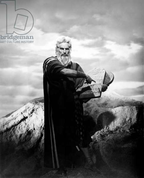 Charlton Heston dressed as Moses holding the Tables of the Law