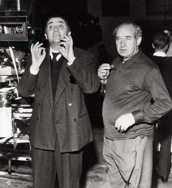 Federico Fellini with Otello Martelli, 1959 (b/w photo)