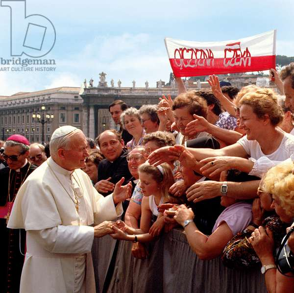 Pope John Paul II shaking hands with the believers, Vatican City, Vatican City State
